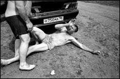 """Bruce Gilden, Sergey Polovtec aka """"Kaban"""" throwing a drunk to the ground, 70 kilometers from Yekaterinenburg, Russia, 2010"""