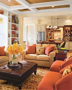 orange chairs and pillows will easily bring a fall feel to the space and a yellow bloom arrangement will help Cozy Living Room Warm, Fall Living Room, Living Room Orange, Chic Living Room, Family Room Colors, Living Room Decor Colors, Living Room Color Schemes, Family Room Design, Colour Schemes