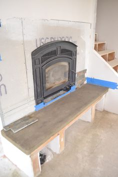How to build a concrete fireplace hearth fireplace for Concrete mantels and hearths