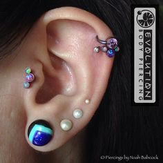Helix and tragus piercings with opal and titanium jewelry by Anatometal (at Evolution Body Piercing)