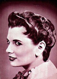 The Holy Grail of glamorous short hair. A 1955 example of the petal coif, a stylish vintage option for those with short hair, a la Elizabeth Taylor & Audrey Hepburn. Can't wait!
