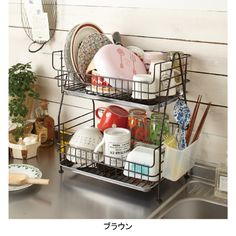Great little shelf for dish drying.....I hope to find one in Sterling, Il.   at My Apron Strings antique store.  right across from the little Chocolatier