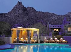 The outdoor pool at Scottsdale Four Seasons Resort. Were you can find an outdoor oasis of mountain and desert views. Surrounded by foliage and chiase lounges, the waters of our free-form bi-level pool are heated for year-round enjoyment. For more information and hotel collections, visit www.guestmob.com.
