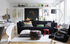 Black Ikea Stockholm sofa with the velvet Sandbacka cover, along with a floor lamp covered in the black Elefant fabric from Svenskt Tenn (Estrid Ericson design). If it was up to me, this would be our next family sofa. But alas, it won't.