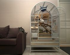 parrot cage modified for other animals... I like this idea for a chinci ;)
