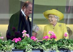 Philip and the Queen are all smiles as they share a tender moment inside the Royal Enclosure on the first day of Royal Ascot 2016.
