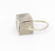 Sterling silver and Steel Hollow Form ring.