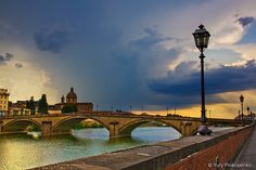 Florence, Italy - Late afternoon thunderstorm over River Arno and Ponte alla Carraia