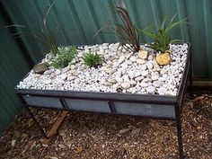 mini playscape in an old trough