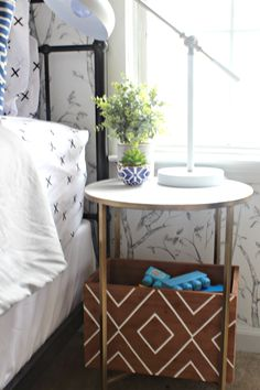 Great idea to put a storage bin under the simple bedside table.