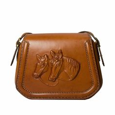 A piece of art! One of a kind! Real saddle leather! This handbag is available only to order. #leather #purses #handbags #horse #cowgirl #barrelracing #ranchlife #cowgirls #leatherjacket #cashmere #saddle