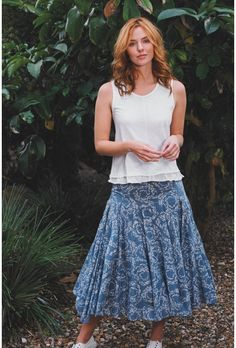 In a Mistral favourite style, our Shoaly Knot Airy Fairy Skirt is made from lightweight cotton voile that drapes elegantly below the knees. Sitting comfortably on the waist with a flattering jersey waistband, the full and floaty skirt features a swirling fish print in a soft copen blue, soft pleating and dobby inserts. Pair with one of our jersey tops for a casual look.   100% cotton   This skirt is 29 ins / 74 cms from the highest point to the hem in a size 12.