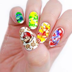 NEW VIDEO! 💅🏻🎮 A fun and colorful nail art design inspired by the new Paper Mario Color Splash game that just came out for the Wii U today! 🎉 And just wait until you see how Minnie created those paint splatters... 😳😍 Link in bio! ▶️ QOTD: What's your all-time favorite video game? Mine is Ocarina of Time ✨