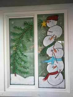 Snowman window decorations by The wicked windows of Tracy, CA