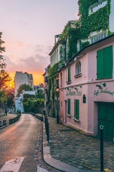 LA Maison Rose, Montmartre. The best time to photograph La Maison Rose, a restaurant in Montmartre, is in June, when the sun sets at the end of the street as you look down the hill. The lights also good early in the morning.