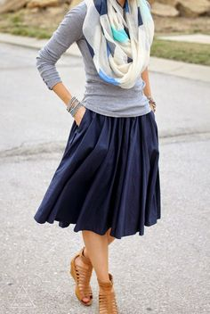 Navy midi skirt, grey tee, printed scarf, gladiator sandals.