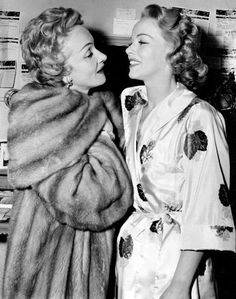 "Marlene Dietrich (1901-1992) congratulates her daughter, Maria Riva (b. 1924) after her starring opening night performance in the Broadway drama ""The Burning Glass"", March 1954"