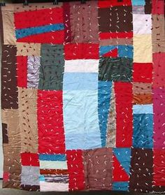 Vintage African-American quilt with knots.