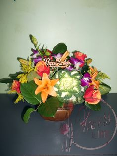 A beautiful birthday arrangement for the autumn child, with kale, asiatic lilies, purple dendrobium orchids, goldenrod and one of our favourite kinds of roses: cherry brandy!