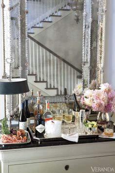 Windsor Smith entertains at home - Ralph Lauren bar items, Gustavian chest, Venetian mirror