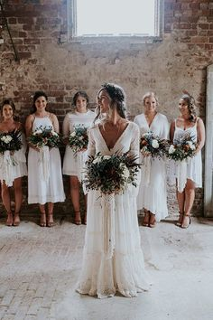 Ellie + Luke wedding featured on Hello May. we love this sweet bohemian style. Would you go barefoot in this gown?
