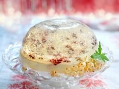snow globes - vanilla jelly dome comes sprinkled with coconut flakes on a base of white chocolate and cranberry pannacotta