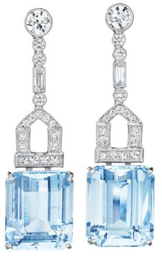 A Pair of Aquamarine and Diamond Ear Pendants. Each suspending a rectangular-cut aquamarine, weighing approximately 30.45 carats in total, from a square and circular-cut pavé-set diamond link, to the collet-set circular-cut diamond surmount, mounted in platinum, length 2 inches. Via Phillips.