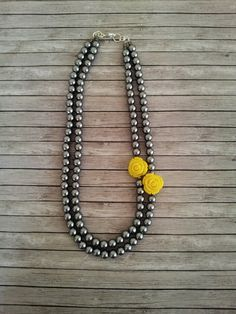 Statement grey yellow rose necklaceGrey yellow by Karavakishop, $34.00....Maybe for mother of the bride with a gray dress?