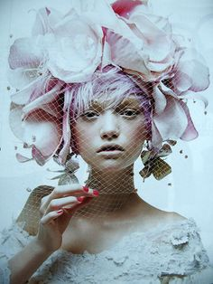 Melancholy unsaturated grey and pink. Girl wearing floral head dress and earrings. Gemma Ward wearing Christian Lacroix Haute Couture for Harper's Bazaar Spain June 2004 photographed by Patrick Demarchelier