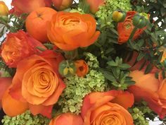 bunch of flowers with rose ranunculus and mandarines