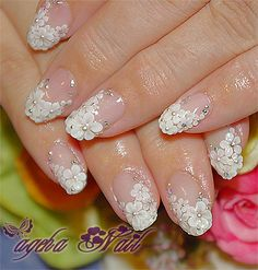 Now this is elegant! How pretty with the delicate white petal. Perfect for a wedding! #nailart #naildesign #nails