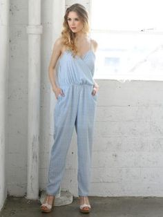 2bb7b1f1e57 Blue Skies Jumpsuit with adjustable spaghetti straps and a wrap front Blue  And White One Piece