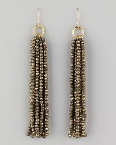 I think these would shimmy and flow well and look great with jeans or after five.  Beaded Tassel Earrings by Nest at Neiman Marcus.