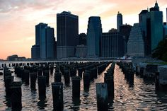 WEBSTA @ aperturium - A shot of the Financial DIstrict from Brooklyn. ISO 400, 50mm, f/5.6, 1/125 sec. Nikon D750. #NewYork #NYC #Photography #sunset #wharf #pilings #geometric #skyscraper #wallstreet #travel #picture #nikon #nikkor #primelens #photographer #photooftheday #photoshoot #picoftheday #pictureoftheday #newyorkcity #sunsets #reflection  #instagood