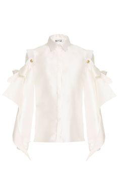 This **Alexis Mabille** blouse features a pointed collar, full length sleeves, and oversized bows at the shoulders.