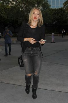 Hilary Duff street style with black blazer, skinny jeans and biker boots.