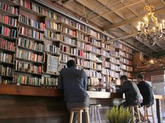 A cafe with a huge library