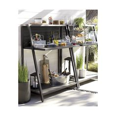 Shop Alfresco Grey Work Station.   Five removable hooks on the back slats conveniently hang tools for cooking, gardening or bartending so it can work as a potting bench, outdoor serving table or outdoor bar.