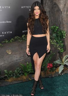 Fancy footwear: The 15-year-old Kylie Jenner wore a pair of open-toe, mid=calf, caged boots