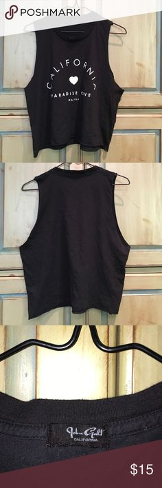 "Brandy Melville Muscle Tank Top Brandy Melville muscle tank top ""California paradise cove Malibu"" black - one size. Worn once Brandy Melville Tops Muscle Tees"