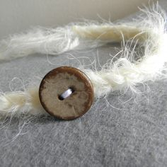 Baby headband halo crocheted cream white ivory with rustic brown button photography photo prop newborn toddler girl soft crochet textured. $11.50, via Etsy.