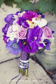 Bouquet with purples, cream and just a touch of pale yellow.