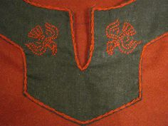 Norse ravens embroidered on linen trim by The Midgard Seamstress, via Flickr