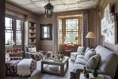 Shingle Style Hamptons Home Designed by Robert A.M. Stern Architects. Steven Gambrel designed. Library walls are antiques oak. Plaster ceiling is overlaid with a chinoiserie fretwork.