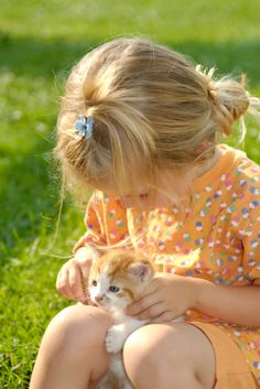 """""""A Well-Matched Loving Friendship."""" (The kitten is a similar colour to the little girl's dress!)"""