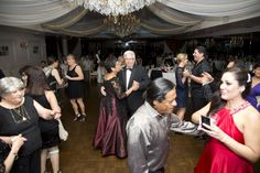 Nothing tells us we're doing a good job more than seeing a busy dance floor! DJ Izzy did just that for Christina and Juan and their guests. At the Royal Fiesta in Deerfield Beach. Photography by Joel Black of Let's Party Photography.