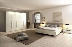 Bedroom Design White Cabinets Unique Lamp Wood Flooring White wall Wooden Door