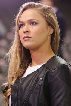 Ronda Rousey, just look at her facial expression... she doesn't give a shit what they think. LOL!! You go girl!!