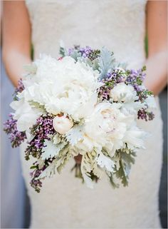 The small purple floral accents go perfectly with the ribbons of purple though the peony's. Classy and beautiful, created by Black Dahlia Design and captured by Kelsey Combe Photography.