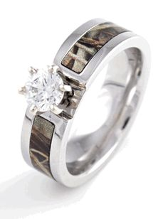 OMG i have a few friends & a future sil that might like this!!!   Sara & Kristin???  Maybe my brother pat fi r wedding band?   Camouflage Engagement Band.. you've got to be kidding me.